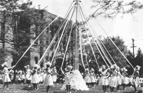 The traditional May Pole Dance adds beauty to the 1965 May Day celebrations.