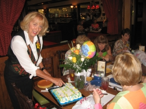 Deedy Dryden cutting the birthday cake