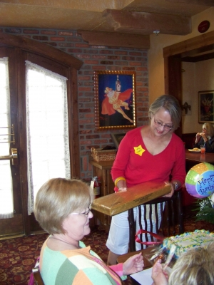Jeri Jones opening the box of Esther Price chocolates Sandie Sturdivant sent in memory of Nancy. There was so much candy