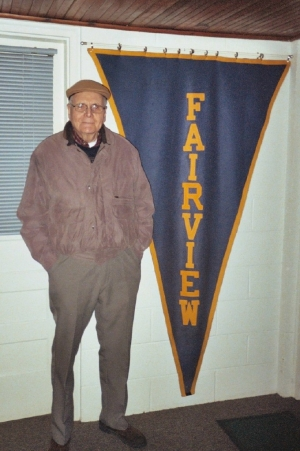 Herman Romeiser the Class of '40. He is standing next to an old FHS banner which hung at Nancy Marker's house. Herman
