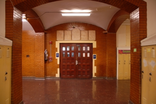 Photo by Bob Hauff FHS Class of 1963. The photo shows the entry to the school library and the Four Freedom Reliefs displ