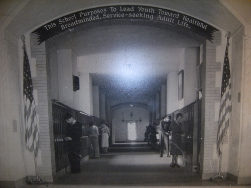 The banner displaying the school motto was attached to the archway over the main hallway of Fairview. The main entrance