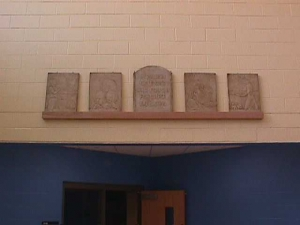 The Four Freedoms plaques once hung above Fairview High School's library door.  They are now displayed in the new schoo