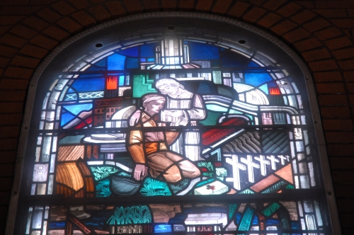 Top section of the World War II stained glass window created by Robert and Gertrude Metcalf.