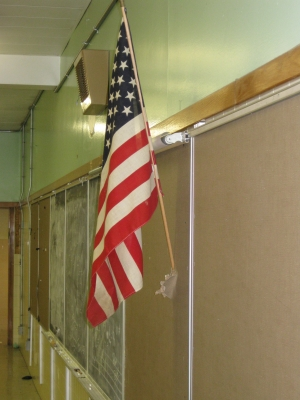 Stars and Stripes still standing. Is it being held up by tape?