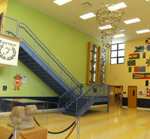 Lobby of new FPK school showing the Metcalf stained glass, new bronze plaque (obsured in this photo by the stairway) and